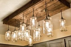 Mason Jar Wood Pallet Chandelier is part of Farmhouse kitchen lighting - This is the perfect mason jar pendant lighting chandelier for your home The Mason Jar Light is completely handmade with a wo Mason Jar Chandelier, Mason Jar Lighting, Chandelier Pendant Lights, Mason Jar Light Fixture, Diy Mason Jar Lights, Rustic Chandelier, Chandeliers, Diy Luminaire, Luminaire Design
