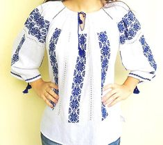 This is an amazing gorgeous Romanian blouse, of folklore inspiration, but adapted to meet the modern fashion. It is delicate, elegant and it will make the wearer stand out of the crowd! Great to combine with a pair of jeans or a fancy skirt, this blouse is a must have! It is entirely