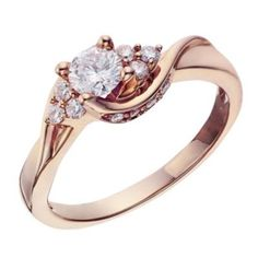 Love this 18ct Rose Gold 0.50 Carat Diamond Twist Solitaire Ring