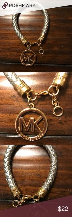 NWOT Michael Kors silver leather gold bracelet Brand new. Never worn. Just sitting in my jewelry box.  Silver leather braid with gold hardware. MICHAEL Michael Kors Jewelry Bracelets