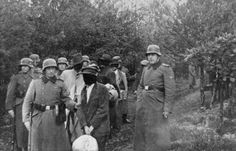SS personnel lead a group of blindfolded Polish prisoners to an execution site in the Palmiry forest near Warsaw. These civilians had been held in the Palmiry and Mokotow prisons in Warsaw.DateOct 1939 - Dec 1939