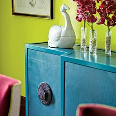 Confidence with Color | Sideboard | SouthernLiving.com. love the large knobs and intense color contrast