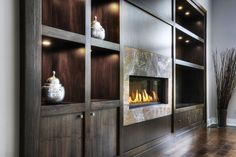 Contemporary built ins with wall mounted fireplace, with lighting Wall Mounted Fireplace, Fireplace Built Ins, Fireplace Surrounds, Built In Cabinets, Custom Cabinets, Walnut Cabinets, Family Room Fireplace, Living Room Cabinets, Elegant Homes