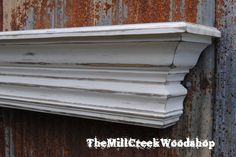 Distressed Wall Shelf 60 Inches Crown Molding Floating Ledge Mantel. $185.00, via Etsy.