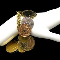 CHUNKY COIN CHARMS! Vintage charm bracelet with a variety of coins looks great with many outfits, $45