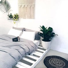 Plants + pallet bed + dreamy macrame + the softest bamboo sheets you'll ever feel = bedroom perfection