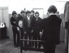 An unknown young teenage fan is lucky enough to get his photo taken with his heroes . Not only is he getting his photo taken with all 4 Beatles , but they are wearing their stage suits , holding their instruments and are about to take the stage for the very last time ever (Though that infomation was known only to The Beatles themselves at that moment ) . A truly Incredible and historic photograph . I hope he kept it :-) . Candlestick Park , San Francisco , 29th August 1966