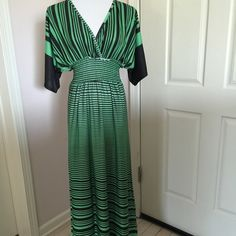 "Long Dress Color: black and green. Stretchable waist. V-neck. Light and comfy. 95% polyester, 5% spandex. I stand 5'2"" it fits me perfect all the way to the bottom. V style at the back. Used once and in excellent condition Christinalove Dresses"