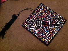 Graduation cap decorating.