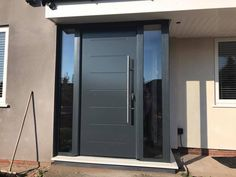 Hormann steel front door and a made to measure aluminium porch all in RAL 7016 colour grey and fitted in Liverpool Door Canopy Modern, Front Door Canopy, Front Door Entryway, Front Door Porch, House Front Door, Glass Front Door, Front Porches, Entry Doors, Garage Doors