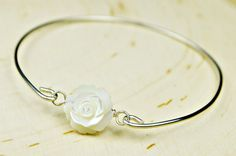 White Mother of Pearl Bangle Bracelet- Large White Carved Rose and Sterling Silver Filled Wire Wrapped Bracelet- Custom Made to Size by SimplyCharmed21 on Etsy https://www.etsy.com/listing/173636947/white-mother-of-pearl-bangle-bracelet