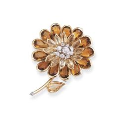 A CITRINE AND DIAMOND CLIP BROOCH, BY CARTIER Designed as a flower with central old-cut diamond cluster and two-tiered marquise-cut and pear-shaped citrine petals, circa 1955, 6.6 cm. high Signed Cartier London, No. 7669
