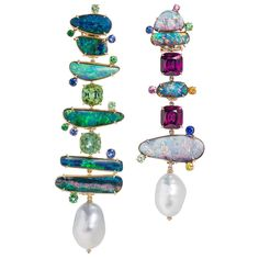 These mismatched earrings from Margot McKinney are set with opals, baroque pearls, green tourmalines, tsavorites and sapphires, umbalite garnets and pink, blue, yellow, and orange sapphires. Discover the baroque pearl harvest that sees incredible jewellery with pearls, opals, gemstones and more designed by the incredible Australian jewellery designer: http://www.thejewelleryeditor.com/jewellery/article/margot-mckinney-baroque-pearls-rock-our-world/ #luxury