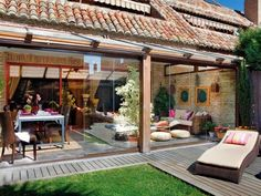 Modern rustic residence with open living room to the backyard deck Porch And Terrace, Porch Garden, Outdoor Spaces, Outdoor Living, Outdoor Decor, Gazebos, Spa Interior, Deck With Pergola, Outdoor Gardens