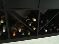 """Description: Cut an EKBY LAIVA shelf to 18"""" in length, then slide it into the EXPEDIT square to make wedge spaces for stacking wine bottles. Slide the shelf into the square so it's about 2-3"""" from the front face of the EXPEDIT, so only the neck of the wine bottles are beyond the shelf. It works great!"""