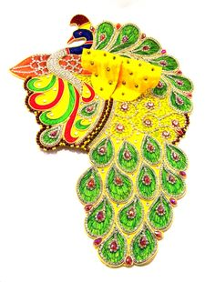 Pitambari Mayur Zari Poshak is a uniquely designed Multicolored (Yellow, Green, Blue) Laddu Gopal dress with a divine Peacock pattern.   This  Designer dress is made by Silk with perfectly finished and durable decorative heavy Zari & Stone work.  There are different color embroidery and other types of work on the Poshak giving it a stunning appearance.    - See more at: http://www.divinekraft.com/POSHAK---DRESS/Pitambari-Mayur-Zari-Poshak-id-1780551.html#sthash.AUB6XWYS.dpuf