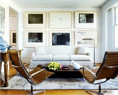 i like the grid of large frames above the couch