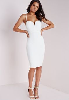 0544536c3e Look seriously seductive in this chic white midi dress. With structured  slight V neck