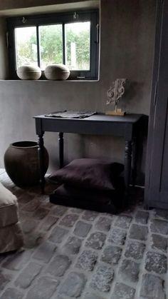 #hamsmade old pottery,  black furniture, raw stones interior decorator