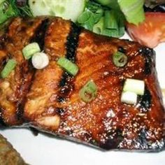 Honey-Ginger Grilled Salmon - This recipe is simple to make, yet impressive. The spicy, sweet, and salty marinade gives the fish a taste that my family goes nuts for! If it's too cold out to grill it, you also may broil it. Grilled Salmon Recipes, Fish Recipes, Seafood Recipes, Great Recipes, Cooking Recipes, Favorite Recipes, Healthy Recipes, Recipies, Grilled Salmon Marinade