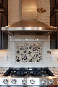 white subway tile with tinted grout. Also love the decorative backsplash behind stovetop