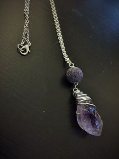 Raw Amethyst Pendant Necklace with Essential Oil Diffusing Lava Bead on Silver Chain by TheScentedSpirit on Etsy