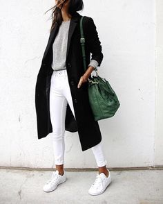 white jeans, white sneakers, black coat, green bucket bag