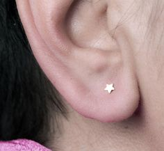 Extra tiny sterling silver star earrings. Cute tiny stud earrings great for everyday wear. This listing is for one pair. The tiny stars measure