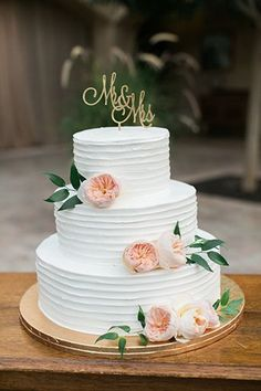 Simple and Elegant spring flowered wedding cake.