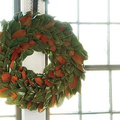 Round Magnolia Wreath: Step-by-Step Instructions   Magnolia wreaths have a sophisticated, Southern look, and they don't shed messy needles like pine versions. Try hanging your wreath with strips of fabric using elsewhere in your room, or with pretty grosgrain ribbon.