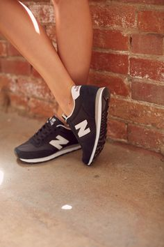 Womens New Balance Black & White 574 Sneakers: the perfect mix of comfy & cool for all your Summer travels