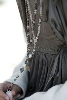gray and long strand of beads fall look
