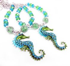 These rhinestone seahorse curtain tiebacks are gorgeous with so much detail and sparkle. The silver seahorse pendant is 2 inches long and hangs from a string of sea blue and green crystal beads. These are so perfect for your beach decor. A beautiful way to decorate your beach