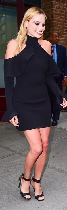 Who made Margot Robbie's black ruffle cut out dress, jewelry, and ankle strap sandals? Elie Saab