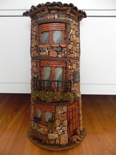 Rock tower faerie house- cover a Pringles cannister? Would be cute in the yard amongst the plants!