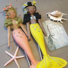 """Curious Pip. on Instagram: """"...A 7 letter word beginning with 'M' An aquatic mammal, a mythical creature, half woman, half fish.....??? 🐚 🦕 Beautiful postcard courtesy…"""" Mermaid Dolls, Mythical Creatures, Tinkerbell, Hand Stitching, Mammals, Art Dolls, Fish, Lettering, Christmas Ornaments"""