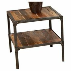 "Equally at home in a country farmhouse or city loft, this handsome end table is crafted from reclaimed wood and showcases an iron frame.  Product: End tableConstruction Material: Reclaimed woodColor: Medium brownFeatures: Rustic finishDimensions: 22"" H x 24"" W x 22"" D"