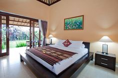 King size bed with wood bed frame Breakfast Around The World, Bed And Breakfast, Kuta, Wood Beds, Bed Sizes, Bed Frame, Master Suite, King Size, Balinese