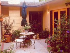 Pretty patio from HGTV. http://www.hgtv.com/landscaping/relaxing-budget-wise-garden-retreats/pictures/index.html