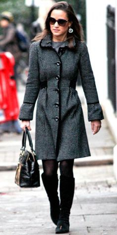 Look of the Day › December 4, 2011 WHAT SHE WORE Middleton walked to work in a tweed trench. Gold danglers, a black tote and suede boots completed the look.