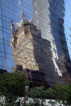 The Sherry Netherland Hotel and the GM Building on 5th Avenue, reflected in the 58th Street facade of the Solow Building.