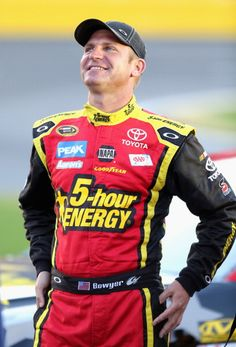 ONCORD, NC - MAY 23: Clint Bowyer, driver of the #15 5-hour ENERGY Toyota, stands on the grid during qualifying for the NASCAR Sprint Cup Series Coca-Cola 600 at Charlotte Motor Speedway on May 23, 2013 in Concord, North Carolina. (Photo by Jerry Markland/Getty Images)