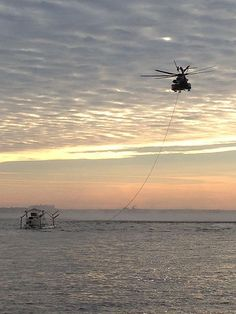 A CH-53E Super Stallion helicopter assigned to the Vanguard of Helicopter Mine Countermeasures Squadron (HM) 14 tows a MK-105 magnetic influence mine sweeping sled into St. Andrews Bay at Naval Surface Warfare Center Panama City. (U.S. Navy photo by Lt. j.g. Jenna Blais/Released)
