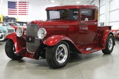 1930 Ford Custom Truck Street Rod 300HP. Interior: Gray/Tan Leather. Exterior: Burgundy.