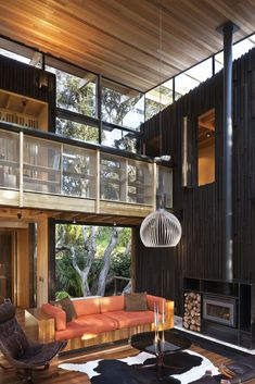 "Lance Herbst, principal of Auckland-based studio Herbst Architects has sent us photos of the Under Pohutukawa project. This two story beach house is located at Piha North, a northern New Zealand coastal settlement. According to Wikipedia, ""It is one of the most popular beaches in the area and a major day-trip destination for Aucklanders throughout the year, although especially so in summer.""                   Under Pohutukawa Residence by Herbst Architects: ""The site with which we were…"