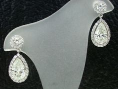 Pear Shape & Brilliant Round Halo Earrings 1.55 CT PS Center 1.56 CT PS Center 0.40 TW BR Tops 0.58 TW Melee