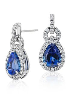 Brilliant color is captured in these 6.68 ct. tw. tanzanite and diamond earrings