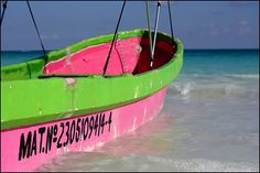 pink and green boat