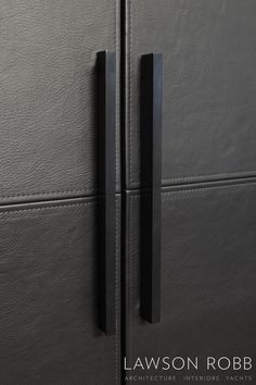 Leather faced wardrobe doors and timber handles - seriously sophisticated.
