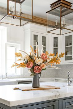 Ready to decorate for fall? Style your favorite fall leaves and faux fall flowers and create a tall, dramatic floral arrangement. The perfect tall centerpiece for your fall home decor. Shop fall flowers and leaves at Afloral.com.